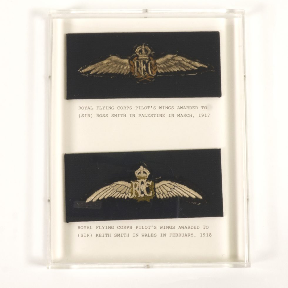Image: two sets of gold braid wings on navy fabric